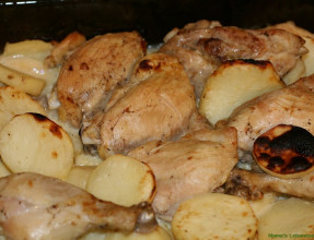 Mix garlic sauce with baked chicken and potatoes then broil for a few more minutes